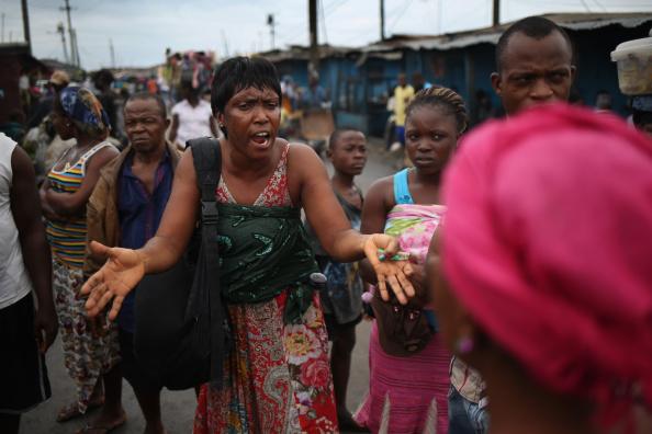 10. Woman.Ebola.Not.Real.453685642.Getty.John.Moore.jpg