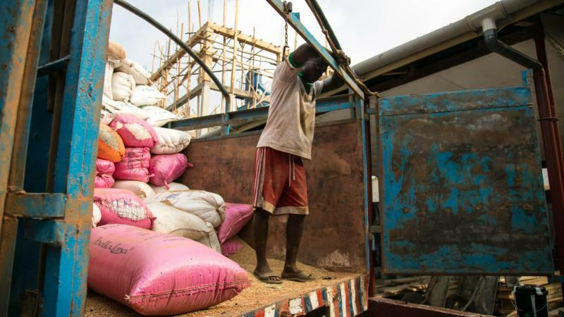 USAID Unloading Rice